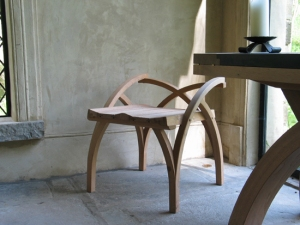 Treble Zero Occasional Chair  in steam bent oak with carved elm seat and washed finish