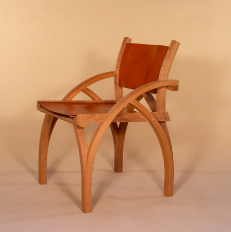 Two Treble Zero Low Back Chair in steam bent oak and oak bark tanned leather
