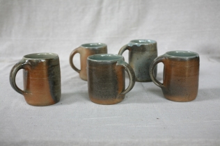 Svend Bayer 78 - 86 Smaller Mugs, wood ash glazed outside with celadon inside, sized from 10 x 8.5cm £32.50 and Bigger Mugs 73,74, 75 (sold), 76 (SOLD), 77 from 12 x 9cm £38 (2)