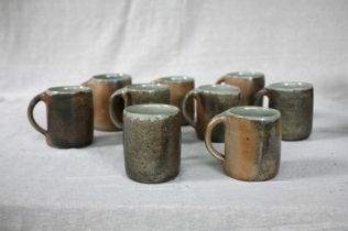 Svend Bayer 78 - 86 Smaller Mugs wood ash glazed outside with celadon inside, sized from 10 x 8.5cm £32.50 and Bigger Mugs (73,74, 75 (sold), 76, 77) from 12 x 9cm £38 (3)