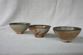 Svend Bayer L to R a different view of bowls, shino glaze, 38. 42. and 41. all 8 x 15cm £100