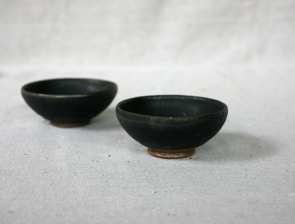 Svend Bayer Small bowls, matt black kaki glaze with wood ash, 66. 5 x 10.5 cm £22 and 67. 5 x 11cm £22