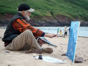 Philip Sutton RA painting on the beach