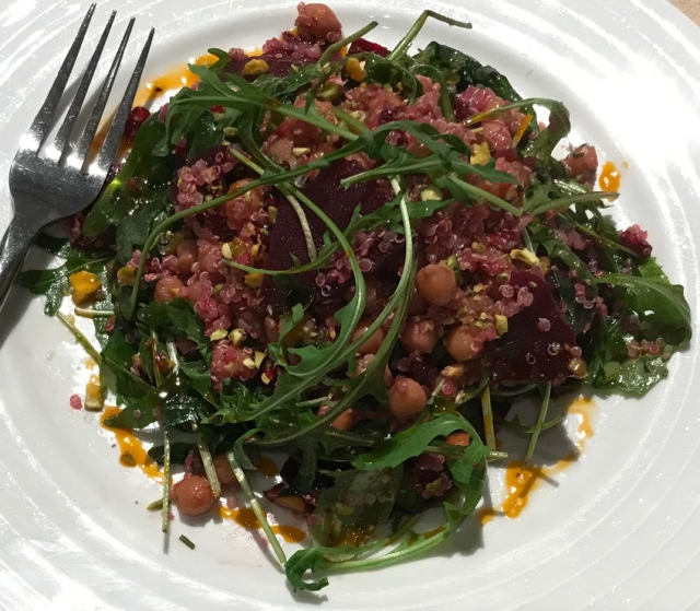 Superfood salad with quinoa beetroot and pistachio nuts closeup